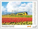 Postzegels voor Postcrossing - trein met tulpenveld